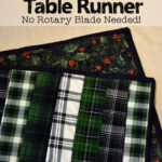 green plaid and Christmas fabric reversible table runner made with the quilt as you go method