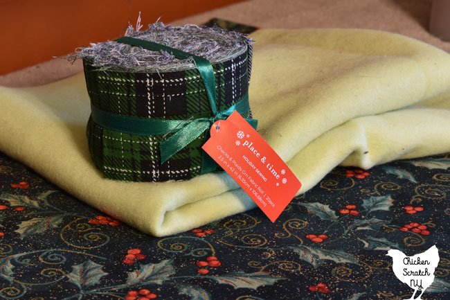 jelly roll, fleece and Christmas fabric for easy quilt as you go table runner