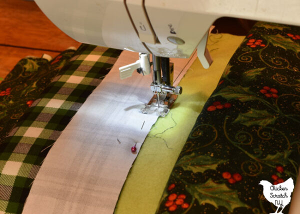 sewing along the side of a jelly roll strip using the side of the presser foot as a guide