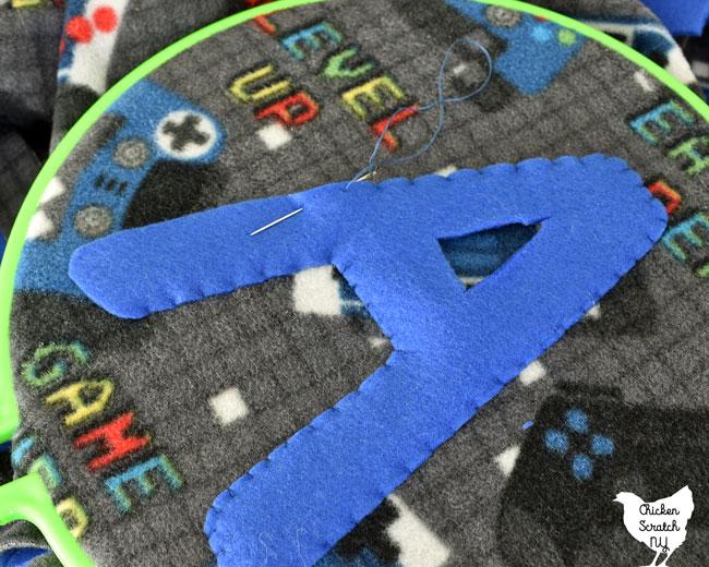 sewing a fleece monogram letter to a fleece blanket