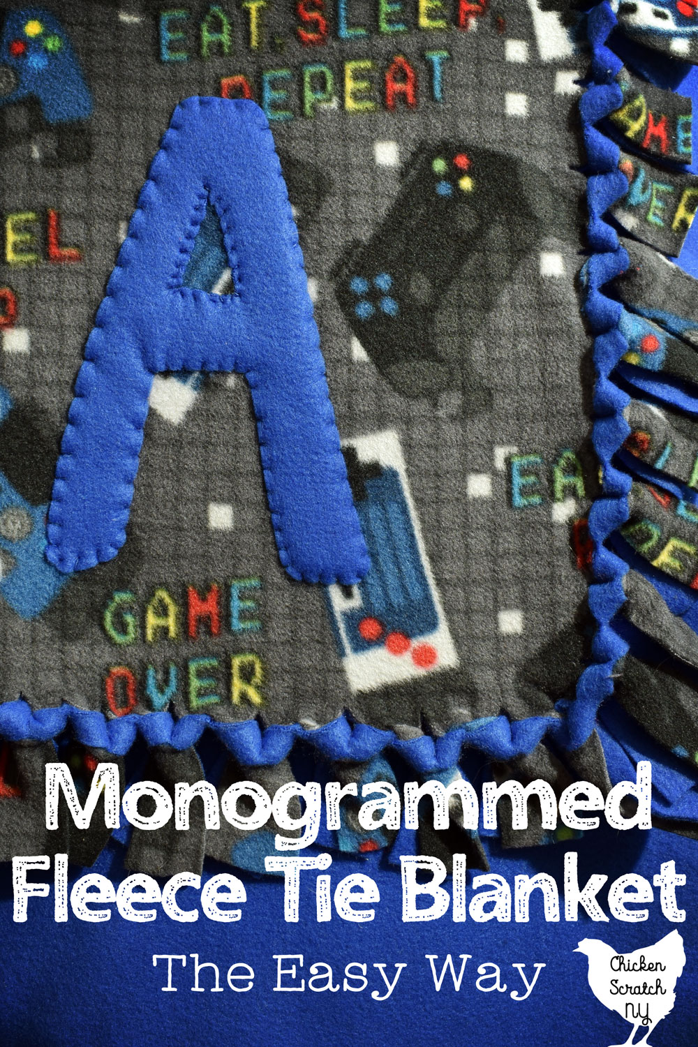 "video game patterned fleece and solid blue fleece tie blanket monogrammed with a large fleece A with text overlay ""monogrammed fleece tie blanket the easy way"""