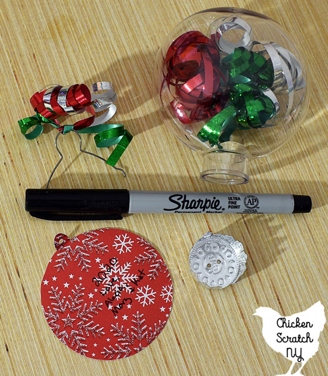 write your names and the year on the back of the tag before reassembling the ornament top