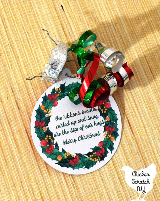 reassemble the ornament top with the tag and a curling ribbon bow