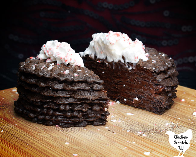 cross section view of a chocolate peppermint ice box cake showing the cookie and pudding layers
