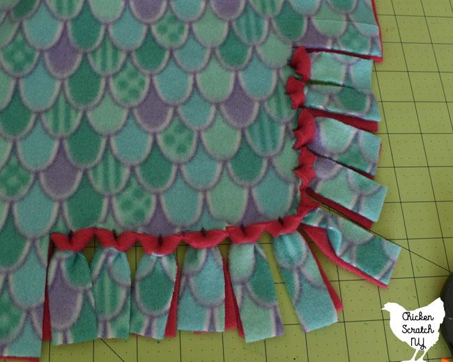 corner of a flipped 2 layer fleece tie blanket