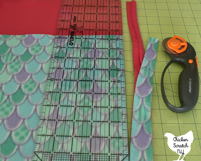 use a rotary mat, rotary blade and ruler to remove the selvage from the fabric