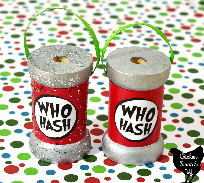 two DIY who hash spool ornaments one with glittery paint and one without