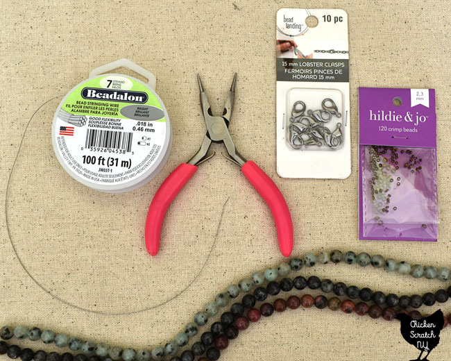 supplies needed for simple diy beaded necklace; beadalon wire, jewelry pliers, crimp beads, lobster claw hooks and natural gemstone beads
