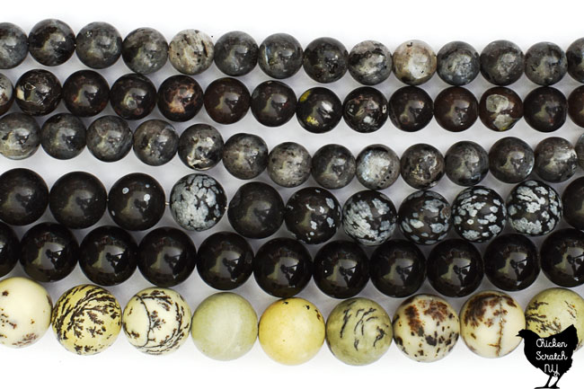 6 strands of black and white natural stone beads including dendritic jasper, rainbow obsidian, snowflake obsidian and black rhyodacite