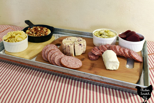 add sliced cured meat to the charcuterie tray