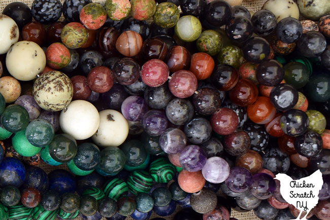 aemiprecious stone beads made into necklaces in a large pile