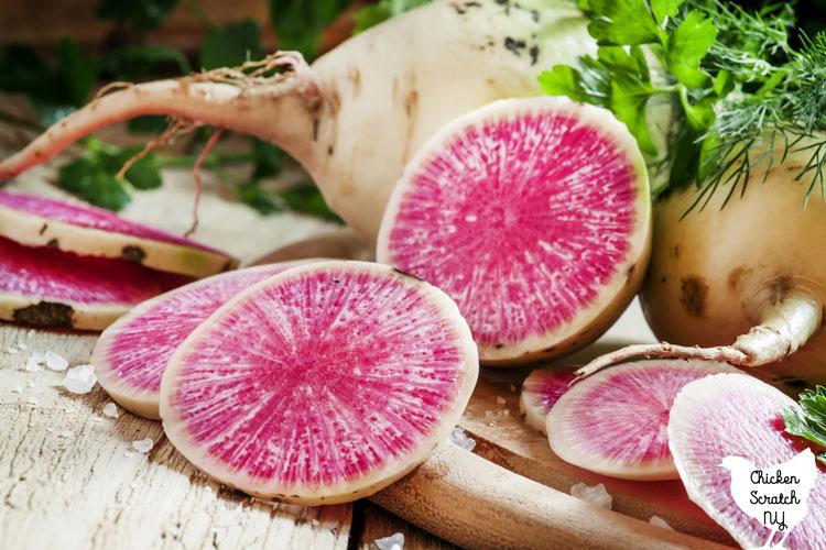 sliced watermelong radish on a cutting board