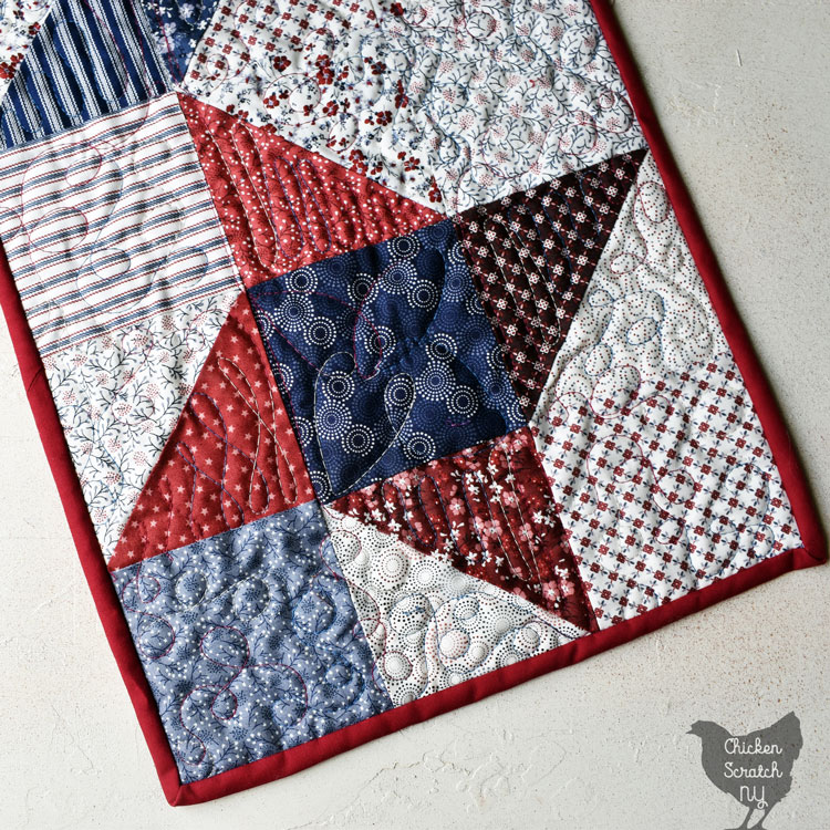 close up view of friendship star made with red, white and blue charm squares
