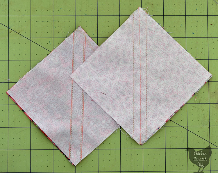 two squares with diagonal lines and two stitching lines to make half square triangles