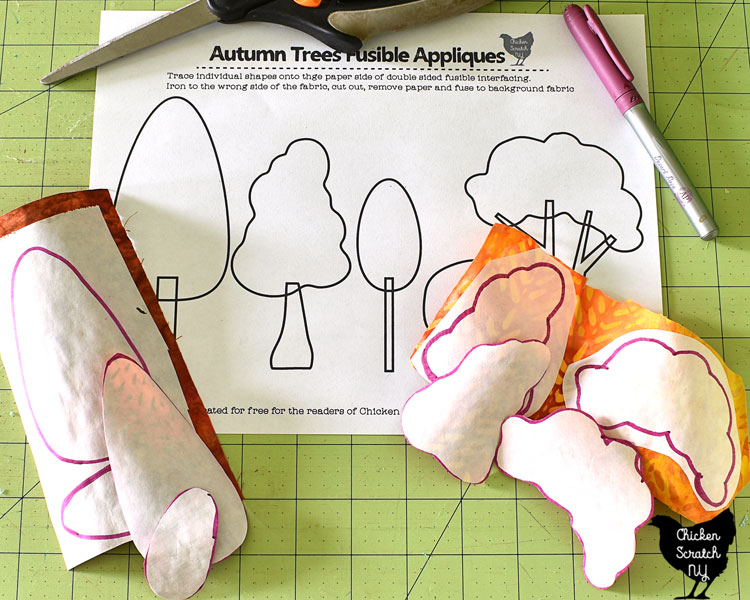 pdf pattern fo autumn tree appliques ironed to orange and red batik fabric