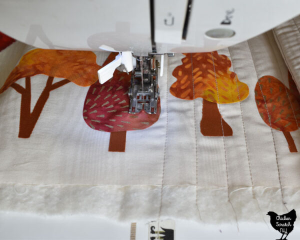 straight line quilting on a narrow table runner with fusible autumn tree shapes
