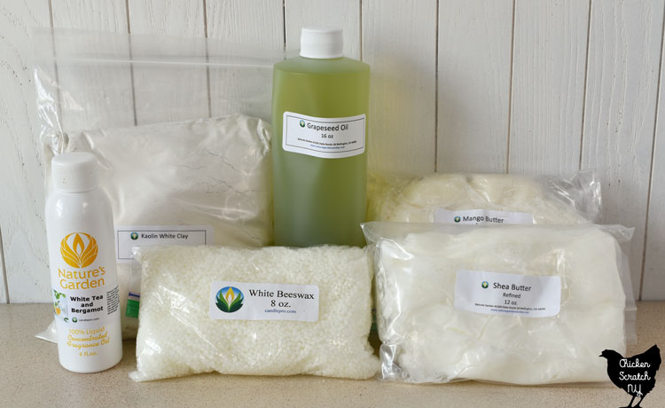 supplies for bath melts including white teas and bergamot fragrance oil, kaolin clay, beeswax, grapeseed oil, mango butter and shea butter