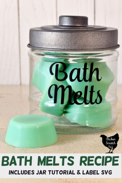 """glass jar with black lid and black vinyl text """"Bath Melts"""" in a script font filled with green bath melts with text overlay """"bath melts recipe with jar tutorial"""""""