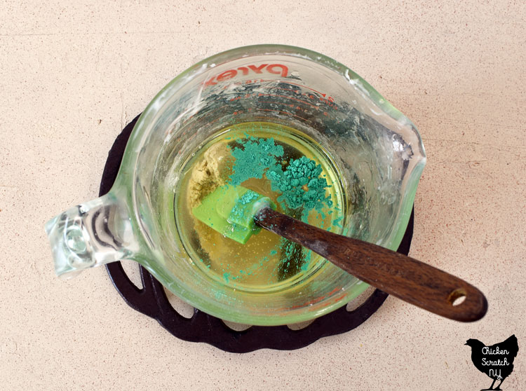 melted bath melt oils with added green mica, fragrance oil and kaolin clay